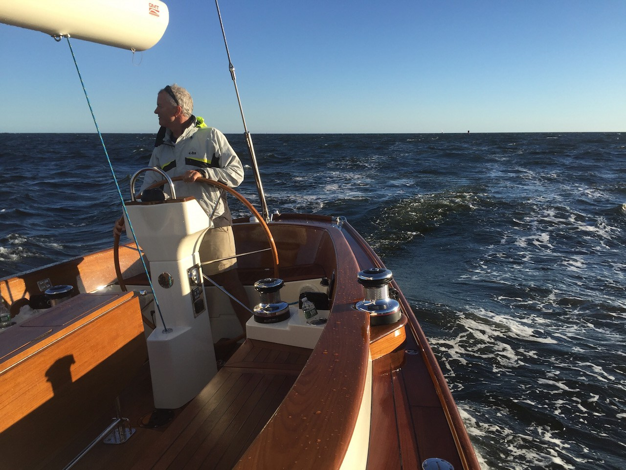 Morris Yacht's Cuyler Morris doing what we all love so much. Sailing a good boat, in a good breeze with a good friend.