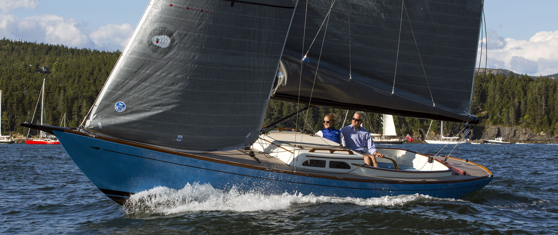 Cuyler and Cindy sail a new M29x in Maine.